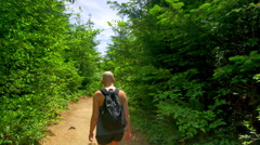 4K Female Bald Cancer Survivor on Hike Down Forest Path Stock Footage