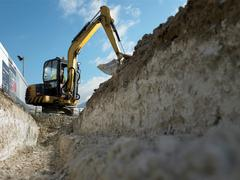 Digger at construction site - stock photo