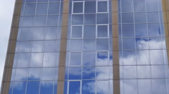 Clouds reflection on a glass facade - modern office Building - time lapse Stock Footage