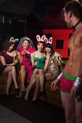 Young women on hen night with male stripper - stock photo