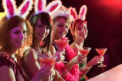 Four young women on hen night Stock Photos