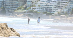 4K Young boy & his sisters playing in the water on beautiful South African beach Stock Footage
