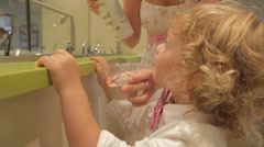 Children Dressed Up Eating Frozen Yogurt On  Summer Day Stock Footage