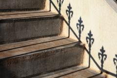 Steps and railing shadow - stock photo