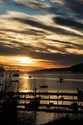 Silhouetted boats on sea, Salt Spring Island, British Columbia, Canada - stock photo