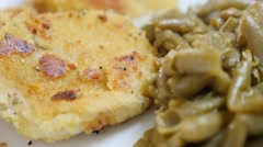 Fried fish and green beans tasty healthy lunch on plate 1920X1080 FullHD tilt Stock Footage
