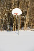 Basketball hoop in snow - stock photo