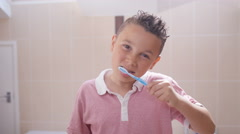 4K Little boy in bathroom cleaning his teeth, as sen from the mirror's pov Stock Footage