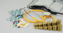 Lot of medicine pill and gold coins step time lapse - stock footage