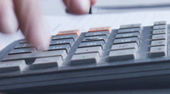 Counting on calculator. Macro. Finger presses the button calculator - stock footage