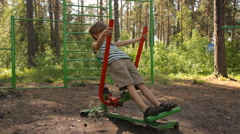 kid training on playground equipmen - stock footage