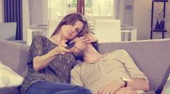 Woman watching tv happy caressing sleeping boyfriend retro style 4K - stock footage
