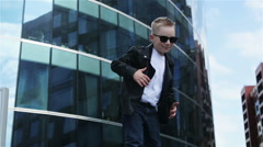 Baby boy 7 - 8 years in sunglasses Stock Footage