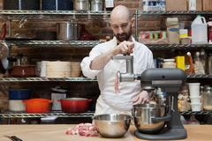 Butcher making ground meat Stock Photos