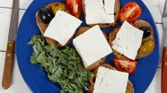 white feta greek cheese sandwich on blue plate - stock footage