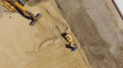 Aerial view of a construction worker on a construction site at work Stock Footage