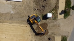 Aerial view of a digger  tracked excavators at work on a construction site Stock Footage