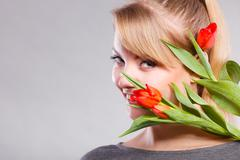 Girl with tulip feel connection to nature. - stock photo