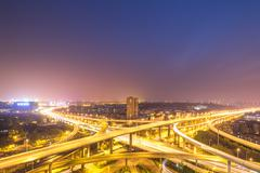 Busy traffic on road junction in nanjing at night Stock Photos