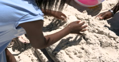 4K Happy family having fun at the beach, burying little boy in the sand Stock Footage