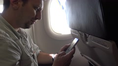 4k Interior airplane, passenger on a plane using Smartphone for text message-Dan Stock Footage