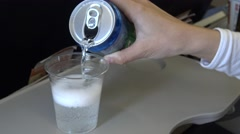 4k The asian woman passenger drink a beverage can in airplane during flight-Dan - stock footage