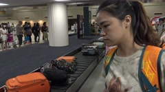 4k asian girl waiting the luggage in Don Mueang international airport -Dan Stock Footage