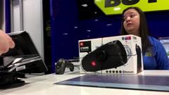 Man paying Tangerine credit card to buy speaker inside Best buy store - stock footage