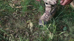 Close up of military ties shoelaces in the forest Stock Footage