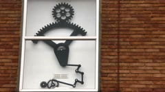 Modern installation of gears and levers on the wall of a building Stock Footage