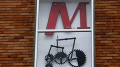 Modern installation of gears and levers on the wall of a building - stock footage