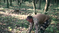 Warrior wears body armor in the forest - stock footage