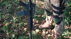 Close up of military puts on automaton in the forest - stock footage