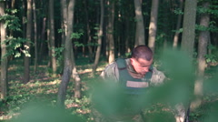 Military puts on automaton in the forest - stock footage