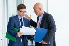 Businessmen talking in office Stock Photos