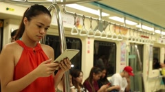 Beautiful asian girl using tablet computer with touchscreen in metro Taiwan-Dan - stock footage