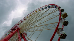 Ferris Wheel on the Background of a Stormy Sky Stock Footage