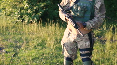 Military man arms automaton in the forest - stock footage