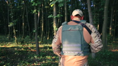 Armed warrior goes in the dark forest - stock footage