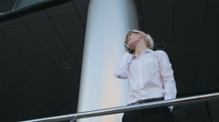 Young Business Woman Making a Phone Call Outside Business Center - stock footage