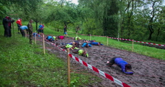A few teams are going very fast across the mud pool - stock footage