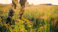 Military foot goes on the grass Stock Footage