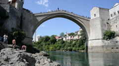 A man diving on the old brigde in Mostar, Bosnia , Bosnia and Herzegovina - stock footage