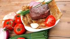 Roast meat : beef ( lamb ) steak garnished with onion Stock Footage