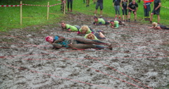 The green team is crawling across the mud pool Stock Footage