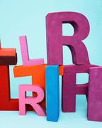Multi-colored oversize letters Stock Photos