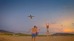 Group of young people having fun on the background of airplane taking off Stock Footage