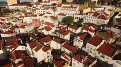 Roofs and narrow streets of Alfama in old Lisbon at morning aerial view Stock Footage
