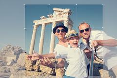 Cropping picture of positive young family for share in social network - stock photo