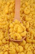 Uncooked italian pasta pipe rigate in a spoon - stock photo
